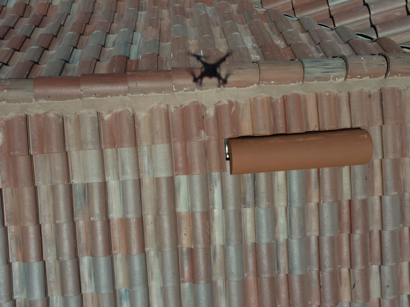 drone flies over roofing for inspection