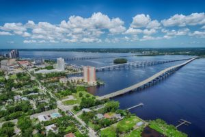 Aerial Drone Photography of highway bridge Edison bridge over Caloosahatchee River water in Fort Myers, Florida