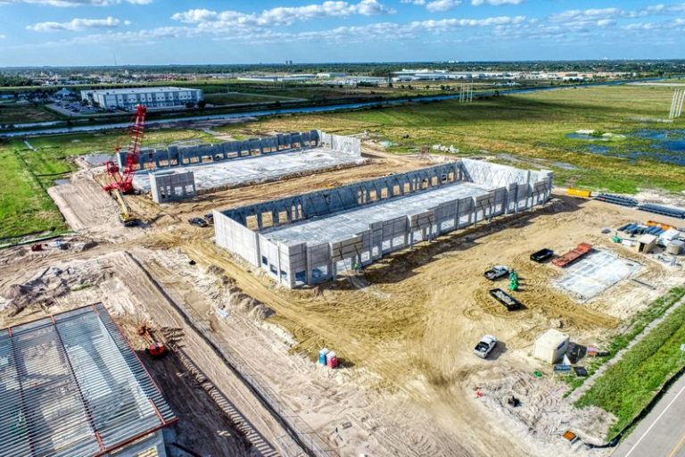 Aerial drone photography of a construction site in progress building a commercial office and warehouse in Fort Myers, Florida